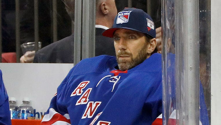 FILE - Then-New York Rangers goaltender Henrik Lundqvist looks on from the bench during an NHL hockey game against the Buffalo Sabres in New York, in this Friday, Feb. 7, 2020, file photo.