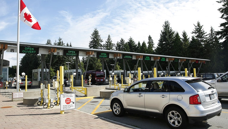 Cars line up at border crossing booths