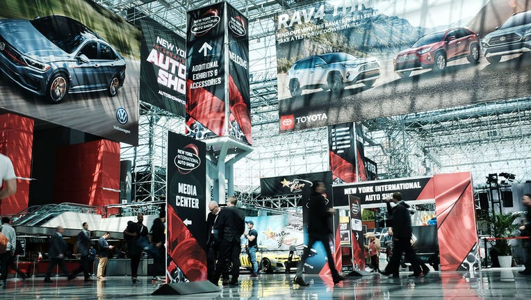 People walk through the New York International Auto Show at the Jacob K. Javits Convention Center on April 17, 2019 in New York City.(Photo by Spencer Platt/Getty Images)
