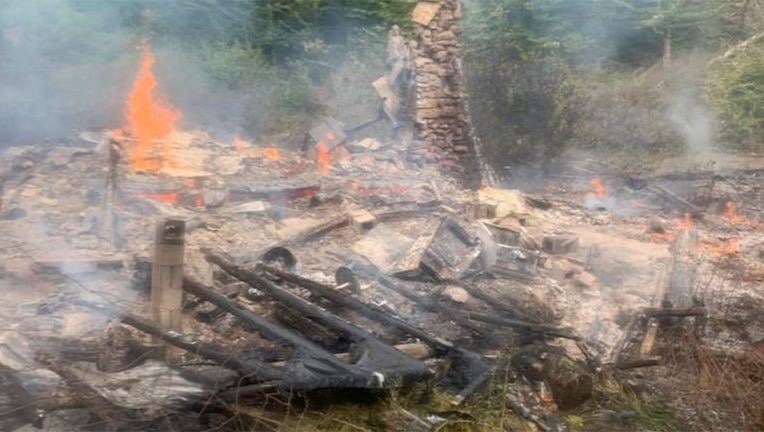 A photo by firefighters shows the burned remains of River Dave's cabin. (Canterbury Fire Department)