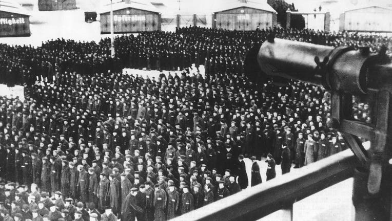 This undated file photo shows a roll call, in the early morning or late evening hours, on the roll call square in front of the camp gate of the Nazi concentration camp Sachsenhausen in Oranienburg on the outskirts of Berlin, Germany.(AP Photo, file)