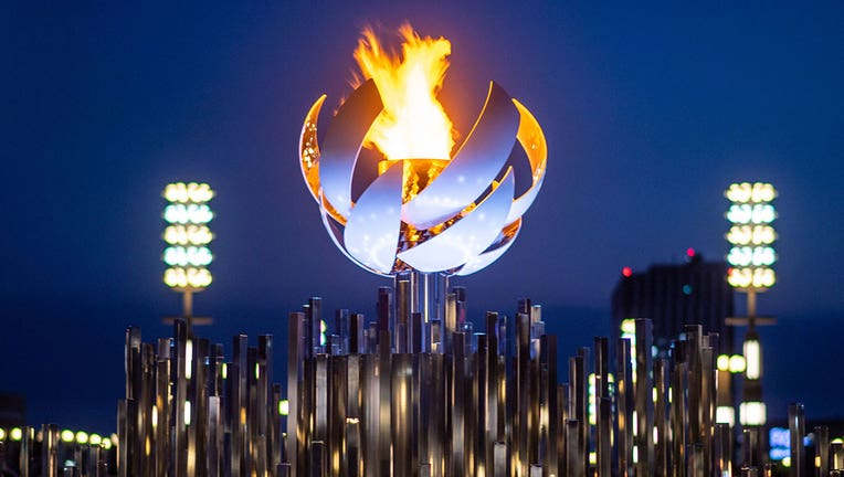 The Olympic flame is seen burning on the cauldron at Ariake Yume-no-Ohashi Bridge in Tokyo on July 25, 2021 during the Tokyo 2020 Olympic Games. (Photo by PHILIP FONG/AFP via Getty Images)