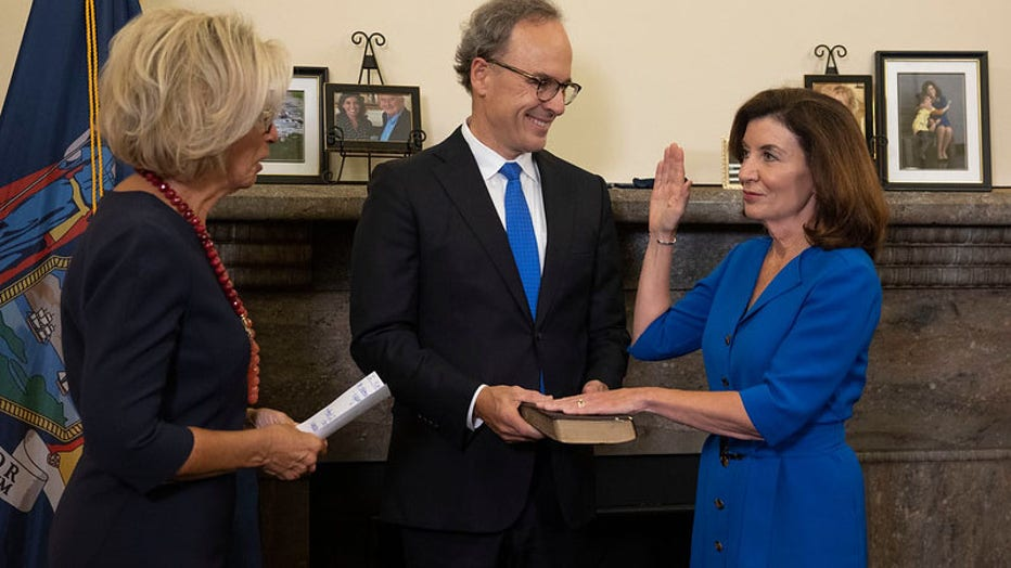 August 24, 2021 - Albany, NY - Governor Kathy Hochul is sworn-in as New York State's 57th Governor by Chief Judge Janet DiFiore during a midnight ceremony at the New York State Capitol. First Gentleman Bill Hochul holds the Bible.