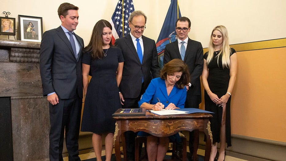 August 24, 2021 - Albany, NY - Governor Kathy Hochul is sworn-in as New York State's 57th Governor by Chief Judge Janet DiFiore during a midnight ceremony at the New York State Capitol. Also pictured are First Gentleman Bill Hochul , Katie Hochul and Matt Gloudeman, and Will and Christina Hochul.