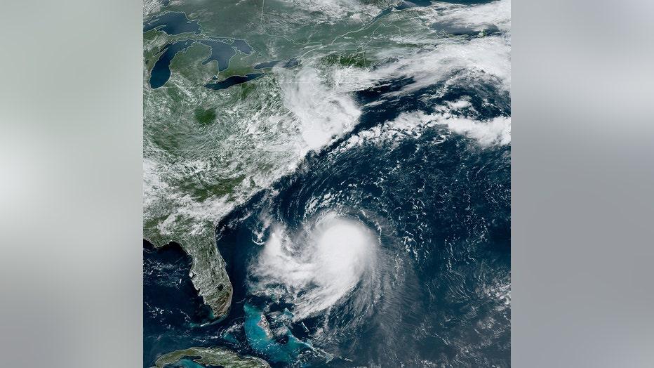 satellite image shows Tropical Storm Henri in the Atlantic Ocean off the Florida Coast