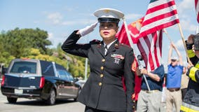 Remains of US marine killed in Afghanistan bombing return home on 9/11