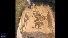 Artist recreates iconic 9/11 photo with power washer