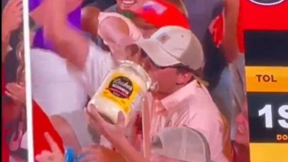 Video: North Carolina man devours tub of mayonnaise at football game