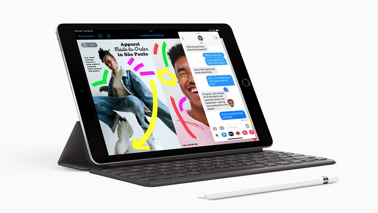 An Apple iPad with optional keyboard and stylus.