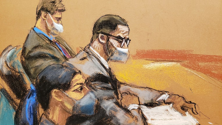 Courtroom sketch shows R. Kelly, wearing glasses and a mask, sitting with two lawyers at a table