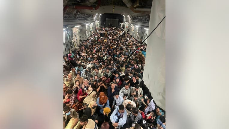 A photo shows a U.S. military plane filled with people being evacuated from Afghanistan in August, 2021.(File)