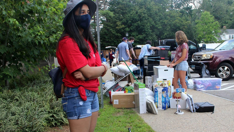 UConn sophomore Sahiti Bhyravavajhala assists students moving into Shippee Hall on the Storrs, Conn. campus, Friday, Aug. 27, 2021.