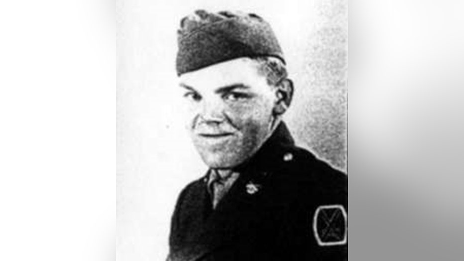 Grainy black-and-white photo of a soldier in uniform