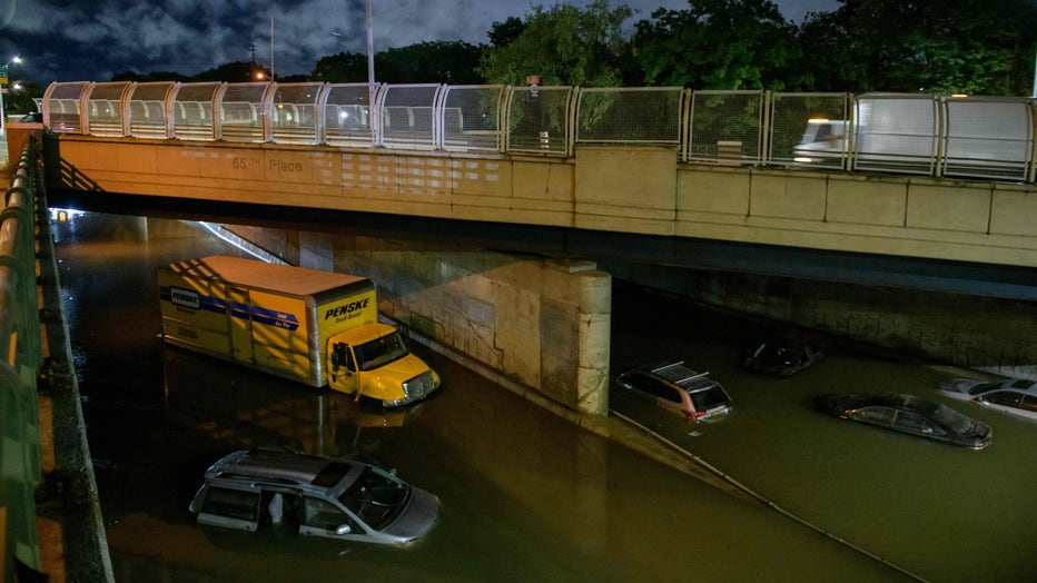 Floodwater surrounds vehicles following heavy rain on an expressway in Brooklyn, New York early on September 2, 2021, as flash flooding and record-breaking rainfall brought by the remnants of Storm Ida swept through the area. (Photo by ED JONES/AFP via Getty Images)