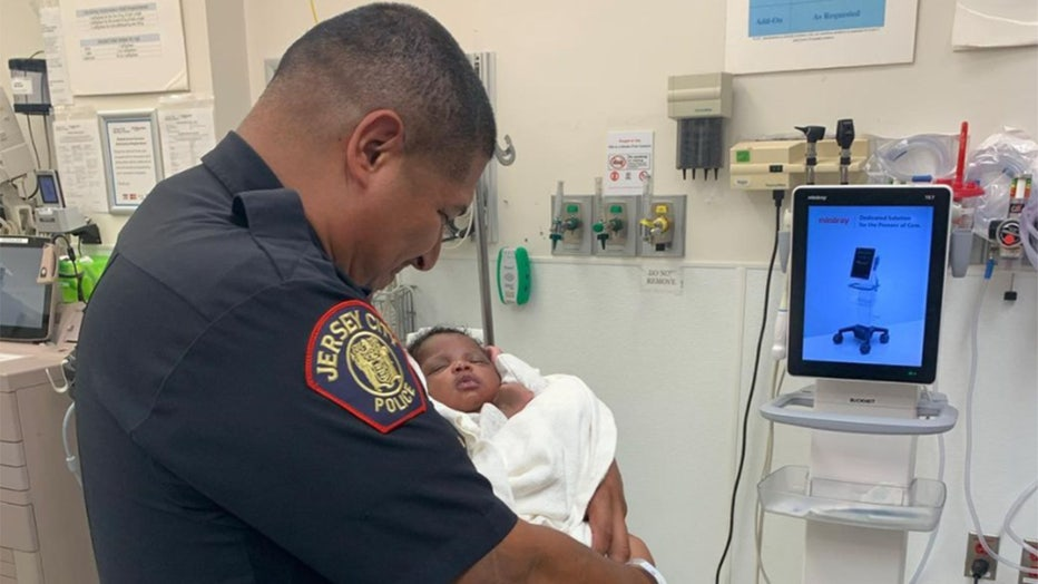 Jersey City Mayor Steve Fulop posted a photo of Officer Eduardo Matute holding the baby he caught.