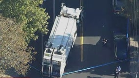 Garbage truck strikes woman leaving her critically injured