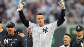 Judge delivers in 9th, Yanks clinch playoff spot in final AB