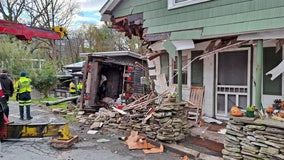 Garbage truck smashes into NY house