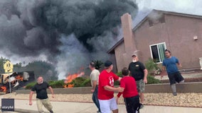 VIDEO: Bystanders rescue woman from burning home after plane crashes, killing 2 in SoCal