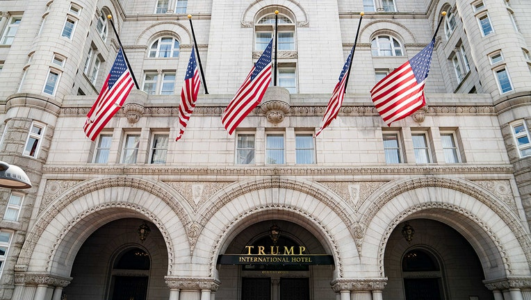 Face of Trump Hotel with 5 Americans flags