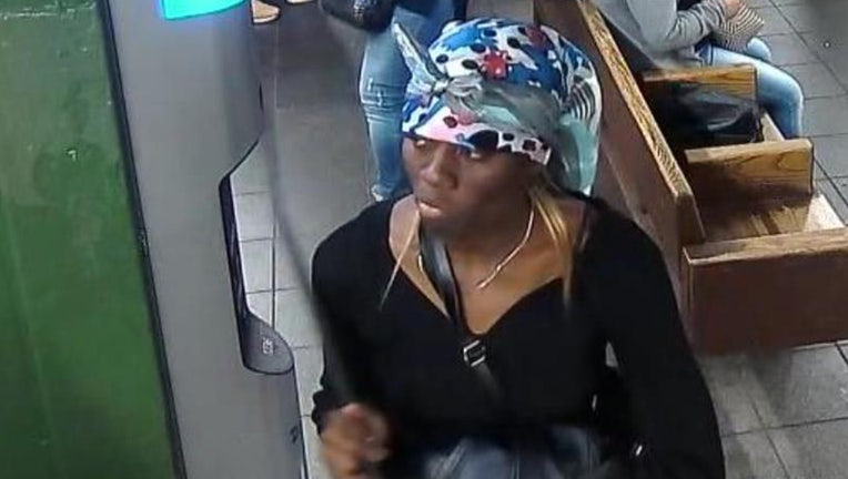 The NYPD released a photo of a woman wanted for shoving a woman into the side of a moving train.