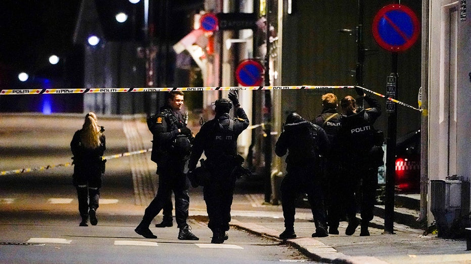 Police officers cordon off the scene where they are investigating in Kongsberg, Norway after a man armed with bow killed several people before he was arrested by police on October 13, 2021.(Photo by HAKON MOSVOLD LARSEN/NTB/AFP via Getty Images)