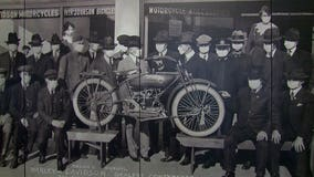 Photo with masked subjects from 1919 welcomes guests to Harley-Davidson Museum
