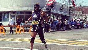 Retired Marine who lost leg in Afghanistan runs Boston Marathon carrying the American flag