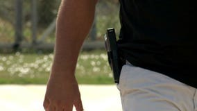 Green Bay official explores ban on openly carrying guns