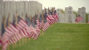Honoring the fallen: Volunteers place thousands of flags at veterans cemetery ahead of Memorial Day