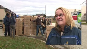 Just in time for Thanksgiving, volunteers fill holiday food boxes for 500 local families