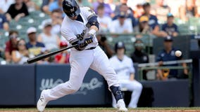 Grandal, Hader lift Brewers over Reds 5-4 to avoid sweep