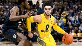 Howard's 17 points lead Marquette past No. 19 Butler, 76-57