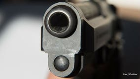 Man kills suspected robber with gun he had in vehicle