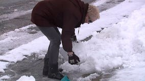 'Hard as a rock:' Heavy, wet spring snow and ice difficult to clean up across Milwaukee