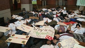 """""""In solidarity with our fallen brothers:"""" Medical College of Wisconsin students stage """"die-in"""""""