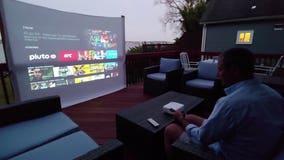 Enjoy a backyard movie night with a mini projector