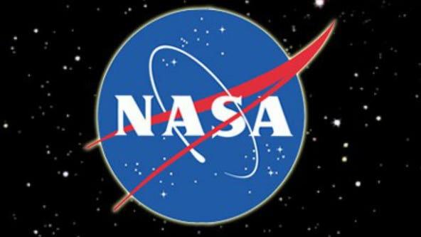 Spacewalking astronauts boost solar power of International Space Station