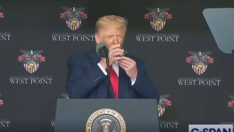 President Donald Trump used two hands to drink a glass of water during a speech at West Point on Saturday.
