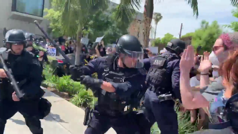 LAPD officers captured on video striking protesters with batons in Fairfax District