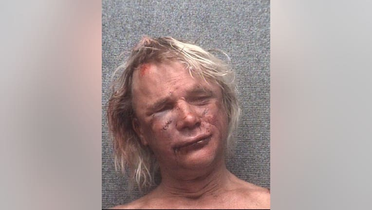 Naked man arrested for lewdness