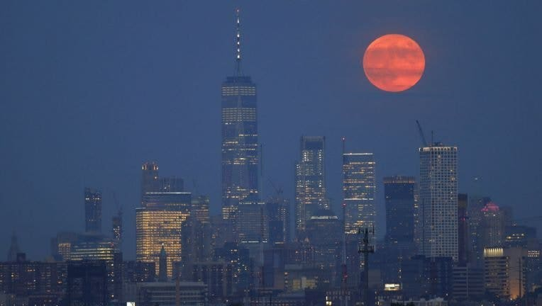 On the 50th anniversary of the launch of Apollo 11, the full buck moon rises above the skyline of lower Manhattan and One World Trade Center in New York City on July 16, 2019 as seen from Kearney, New Jersey. (Gary Hershorn/Getty Images / Getty Images)