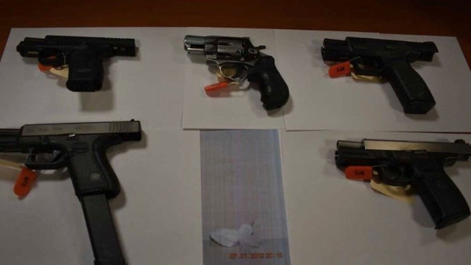 Police recover guns, drugs and cash as search warrant executed at Richards and Clarke