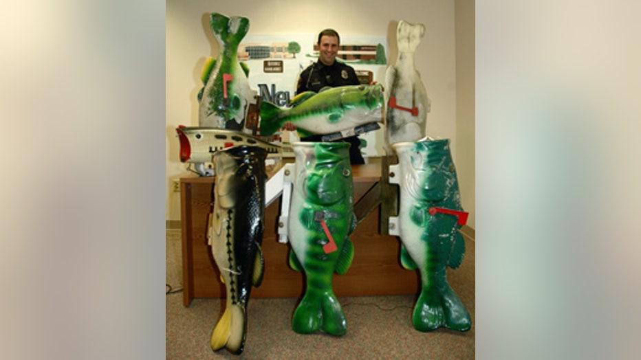 Officer Steve Thompson with the stolen fish mailboxes