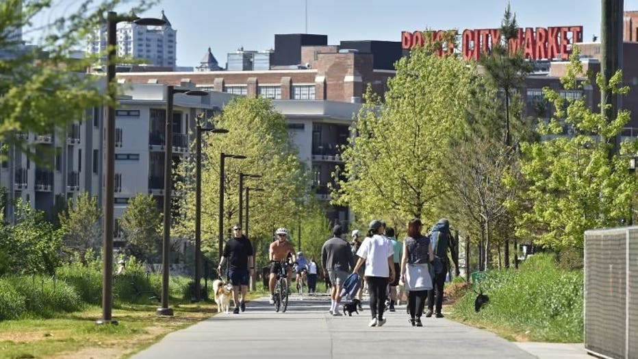Various groups of people walking or biking along the Atlanta Beltline during social distancing (Credit: Austin McAfee/FOX 5 Atlanta).