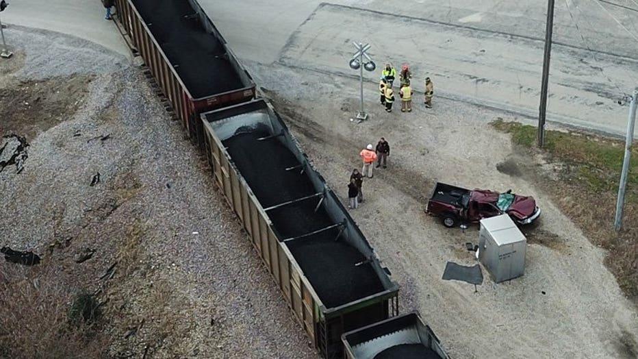SKYFOX over scene of train, truck collision