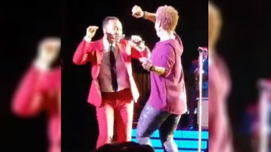 John Legend dances with woman courtesy: @_faith_alexis Twitter