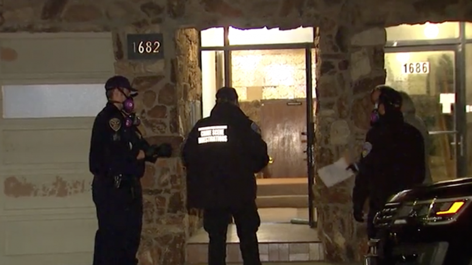 Crime scene investigators on the scene of an apparent homicide at an apartment in San Francisco's Outer Sunset neighborhood. (Courtesy: KTVU)