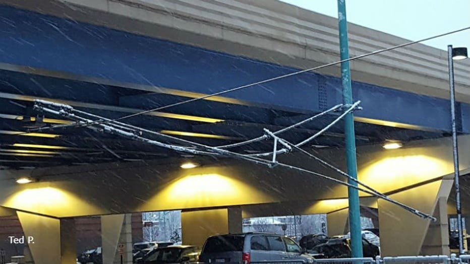 Streetcar cables taken down by snow/ice near I-794 overpass (PHOTO: Ted P.)