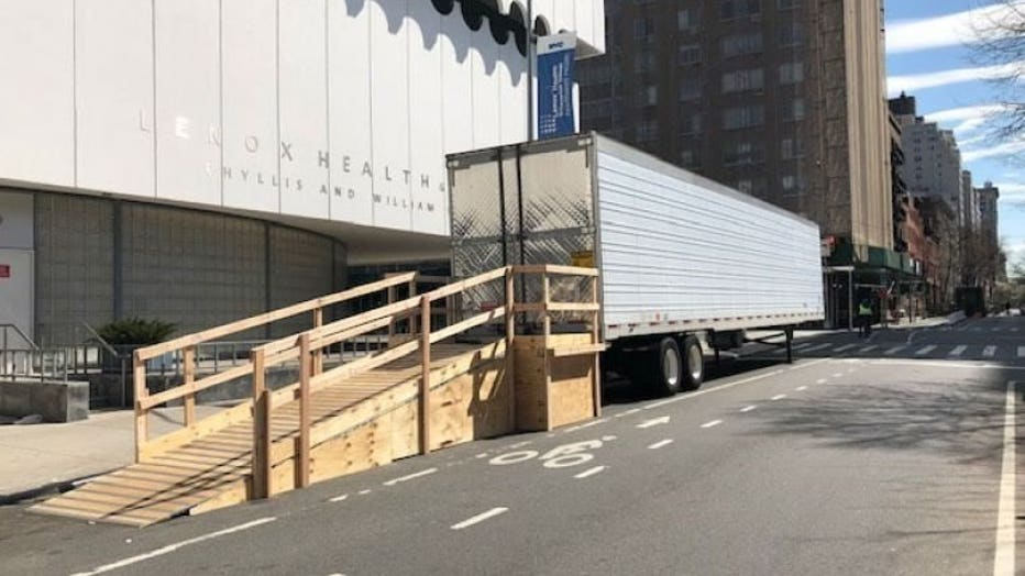 A refrigerated truck is seen outside of a Lenox Hill Hospital facility in the West Village section of Manhattan on Friday, March 27, 2020. (Jose Salvador/FOX5NY)